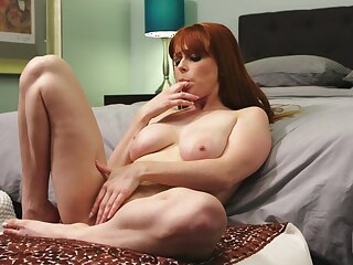 Desirable redhead chick Penny Pax opens her wings to be fucked